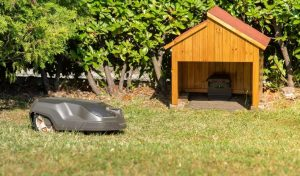 Read more about the article 16 Robot Lawn Mower Garage Ideas [DIY and Ready Made]